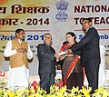 Pranab Mukherjee presenting the National Award for Teachers-2014 to Shri Vinodkumar Parsottambhai Trivedi, Gujrat, on the occasion of the 'Teachers Day', in New Delhi. The Union Minister for Human Resource Development.jpg