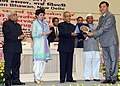 Pranab Mukherjee presenting the National Award for outstanding Services in the field of Prevention of Alcoholism and Substance (Drug) Abuse-2013 to the Nehru Yuva Kendra of Thoubal, Manipur.jpg