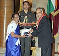 Pranab Mukherjee presenting the Silver Star Award 2011-2012 to the District Organizing Commissioner (G) Cuttack District Association of Odisha State Bharat Scout & Guides, Ms. Rama Swain.jpg
