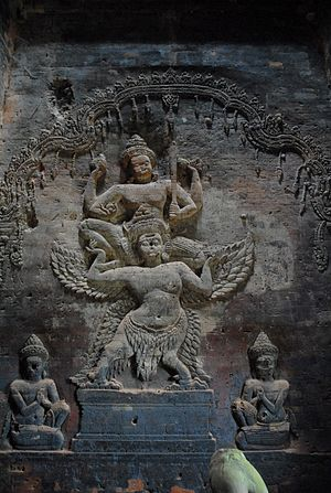 Prasat Kravan - Relief of Vishnu on garuda carved directly out of the brick walls.