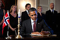 President Barack Obama signs the condolence book during a visit to the Norwegian ambassador's residence in Washington, D.C., July 26, 2011.jpg