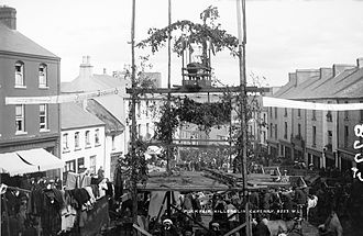 Lughnasadh - The Puck Fair circa 1900, showing the wild goat (King Puck) atop his 'throne'