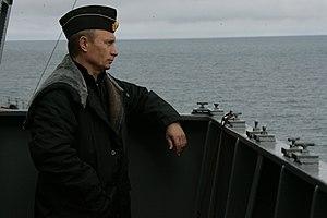 Domestic policy of Vladimir Putin - Putin aboard the battlecruiser Pyotr Velikiy during the Northern Fleet manoeuvres in the Barents Sea, 2005.