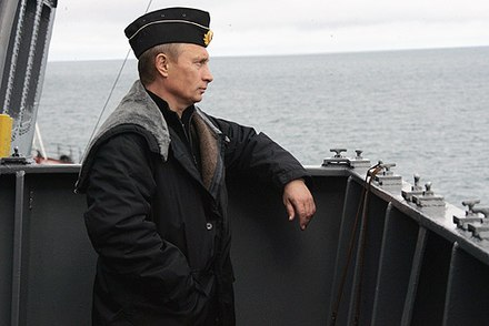 Putin aboard the battlecruiser Pyotr Velikiy during a Northern Fleet exercise in 2005 Pyotr Velikiy battlecruiser 4.jpg