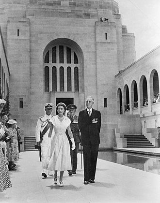 Australian War Memorial - Queen Elizabeth II, being guided around the war memorial by Charles Bean (16 February 1954). The Duke of Edinburgh follows behind in naval uniform.