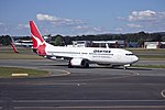 Qantas (VH-VYE) Boeing 737-800 taxiing at Canberra Airport.jpg