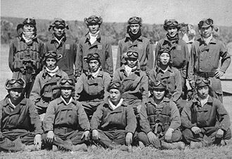Tainan Air Group - Enlisted fighter pilots of the Tainan Air Group pose at Lae in June 1942. Several of these aviators would be among the top Japanese aces, including Saburō Sakai (middle row, second from left), and Hiroyoshi Nishizawa (standing, first on left).