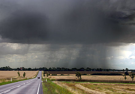 Late-summer rainstorm in Denmark. Nearly black color of base indicates main cloud in foreground probably cumulonimbus. Regnbyge.jpg