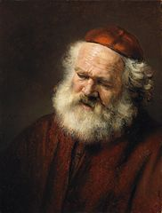 Bust of an old bearded man with red cap