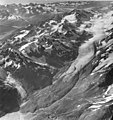 Rendu Glacier, hanging glaciers, outwash, and rock covered valley terminus, August 22, 1965 (GLACIERS 5813).jpg