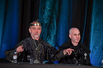 """Lord British - Richard Garriott in his """"Lord British"""" persona, along with Starr Long (right) at the 2018 Game Developers Conference"""