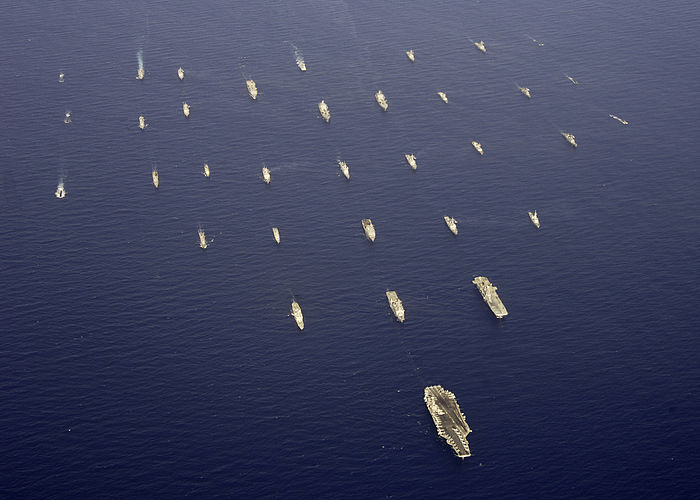 USS Abraham Lincoln leads a formation of ships from eight countries during the Exercise RIMPAC in 2006.