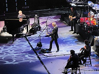 The Elton John Band performing on 15 March 2012. Left to right: John, Johnstone, Birch, and (not pictured, right), Olsson and Cooper Rlton John Band 2012.jpg