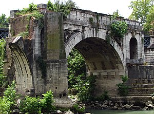 Pons Aemilius - Remaining arch of the Pons Aemilius located in midstream