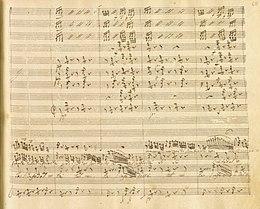 """Rossini: Otello, Akt II, Terzett Desdemona – Otello – Iago, Detail: """"...non cangia di sembiante..."""" Manuskript von ca. 1850, Biblioteca del Conservatorio San Pietro a Majella, S. 124 (Quelle: Wikimedia)"""