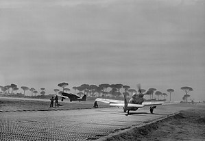 No. 112 Squadron RAF - North American Mustangs of 112 Squadron loaded with 500-lb GP bombs, taxi to the runway at Cervia, Italy, before taking off in support of Operation Olive the spring offensive in the Po valley by the Eighth Army. A Mark III leads a Mark IV