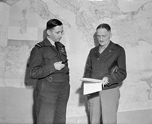 Operation Flax - Air Chief Marshal Sir Arthur Tedder, Commander-in-Chief, Mediterranean Air Command (left), in conference with Major General Carl Spaatz, Commander of the North-West African Air Forces, at Tedder's Headquarters in Algiers