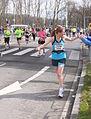 Running woman greeted public marathon.JPG