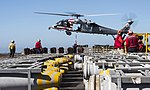 Sailors attach a pallet of ordnance to an MH-60S Sea Hawk helicopter. (35610158775).jpg