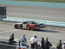 Black-and-red race car, with red Mobil Pegasus