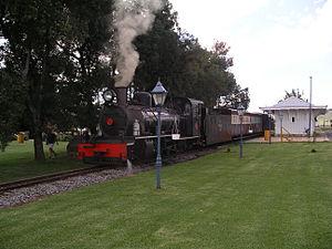 Sandstone Estates - Henschel-built South African Railways NG15 2-8-2 No.17 leaves a station at Sandstone Estates, February 2005