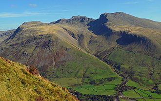 "Lists of mountains and hills in the British Isles - Scafell Pike in the Lake District in Cumbria.  Scafell Pike is the highest mountain in England, and the 257th highest mountain in the British Isles on the Simms classification, the 138th highest mountain on the Marilyn classification, and the 46th highest mountain on the P600 classification.  Scafell Pike has the 13th greatest ""relative height"" (or prominence) in the British Isles.  It is also classed as a Marilyn, a HuMP, a Furth, a Hewitt, a Nuttall, a Wainright, a Birkett, and a County Top."