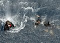 Search and rescue swimmers assigned to the amphibious assault ship USS Nassau (LHA 4) practice hoisting personnel into an MH-60 Seahawk helicopter 080512-N-2735T-719.jpg