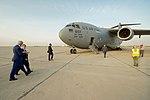 Secretary Kerry Walks With U.S. Ambassador Jones Toward a Waiting C-17 Cargo Plane Before Departing Baghdad en Route to Manama (26247805921).jpg