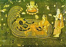 Brahma, the Hindu deva of creation, emerges from a lotus risen from the navel of Visnu, who lies with Lakshmi on the serpent Ananta Shesha. Shesh shaiya Vishnu.jpg