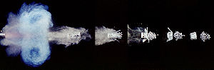 Sabot -  Series of individual 1/1,000,000 second exposures showing shotgun firing shot and expanding cup sabot separation.