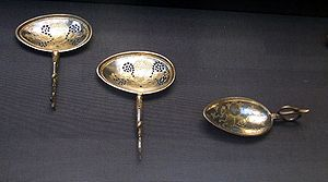 Silver spoon - Two silver-gilt strainer spoons and a cignus spoon decorated with a mythical marine creature. (4th century CE Roman spoons from the Hoxne Hoard.)