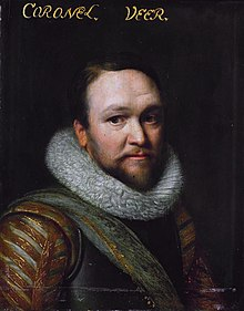 Head and shoulders portrait of a man in 17th century military attire.  He wears a breastplate and a thick, fur collar.  He has a short, brown beard and mustache and a very slight smile.