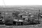 Site of Beaufort Station, near to Beaufort, Blaenau Gwent, Great Britain. Westward view from Heads of Valleys Road over remains of Beaufort Station, which had been on the ex-LNW Abergavenny - Merthyr line and was the junction of a branch to Ebbw Vale (High Level). The branch closed 5/2/51 and Beaufort station was closed with passenger services on the through line on 6/1/58, goods lasting until 2/11/59. A desolate area!