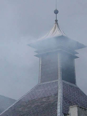 "Single malt whisky - The distinctive ""pagoda"" chimney of a kiln at a distillery in Scotland."