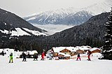 Skislope in the village for children to learn skiing with lessons. In the background the valley covered with clouds. - panoramio.jpg