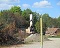 Skogsbranden i Västmanland 2014 - Nedbrunnet hus i Stabäck sett från U668 - 5546.jpg