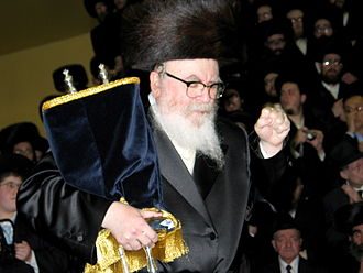 Abrahamic religions - A Jewish Rebbe holds Torah