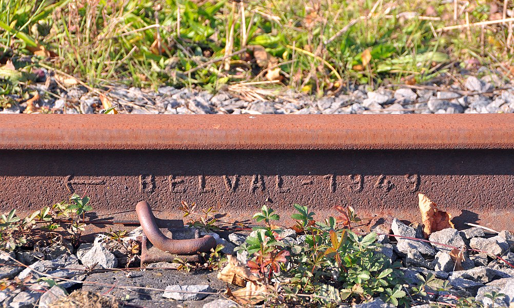 Former railway line #63 Torhout-Kortemark-Ypres (West Flanders, Belgium) in Staden. Detail of a rail with indication of the production date and the manufacturer: the Belval ironworks in Esch-sur-Alzette (Grand Duchy of Luxembourg).