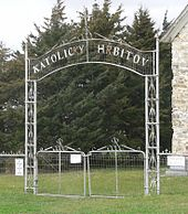 "Metal gate inscribed ""Katolicky Hrbitov"""