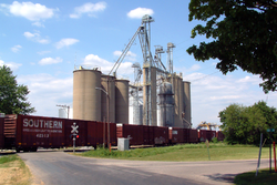 A freight train passing State Line's grain elevators