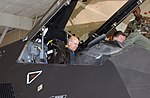 Steve Pearce sits in the cockpit of a US Air Force (USAF) F-117A Nighthawk stealth fighter.jpg
