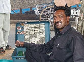 Street dentistry - A street dentist in Bangalore.