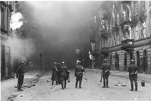 "A Survivor from Warsaw - Stroop Report original caption: ""Smoking out the Jews and bandits."" Warsaw ghetto uprising"