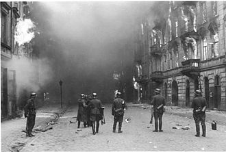 """A Survivor from Warsaw - Stroop Report original caption: """"Smoking out the Jews and bandits."""" Warsaw ghetto uprising"""
