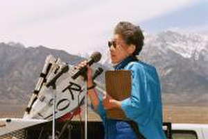 Sue Kunitomi Embrey - Embrey welcoming the crowd at the 33rd annual Manzanar Pilgrimage in 2002