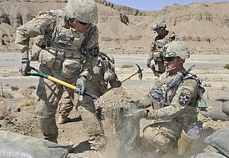 3rd Infantry Brigade, 2nd Infantry Division - Spc. Justin Heimsoth (left) and Sgt. Chris Hagen fill sandbags for a machine gun position during Operation Southern Fist in Afghanistan's Spin Boldak district, Sept. 29, 2012. Both soldiers are infantrymen with the 2nd Infantry Division's 5th Battalion, 20th Infantry Regiment.