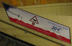 TGV Lyria - An ad for the TGV Lyria service in the Charles de Gaulle - Étoile Paris Métro station