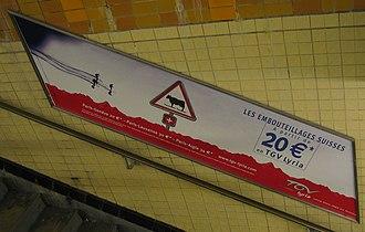 TGV Lyria - An ad for the TGV Lyria service in the Charles de Gaulle - Étoile Paris Métro station