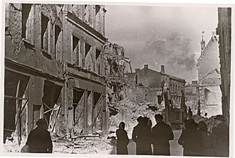 The capital Tallinn after bombing by the Soviet Air Force during the war on the Eastern Front in March 1944 TLA 1465 1 973 Varemetes Harju tanav, vasakul Kuld Lovi varemed 1944.jpg