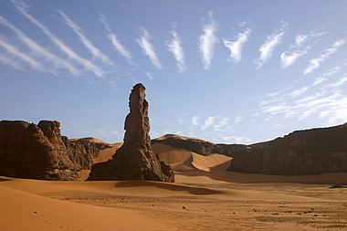 The Moul n'ga Cirque in the Tadrart region, Southeast Algeria, with wave clouds above